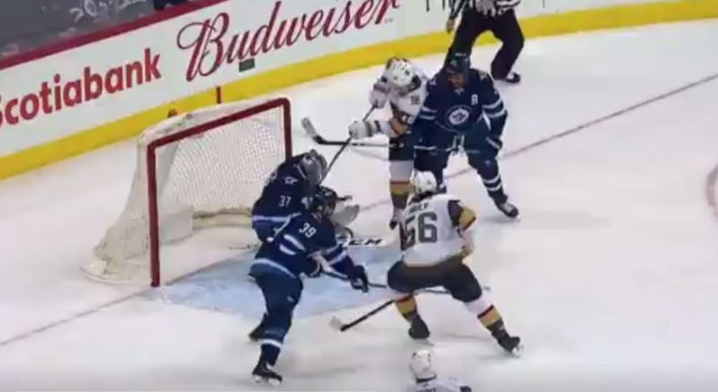 James Neal shatters stick over Connor Hellebuyck's mask, but the goal stands.